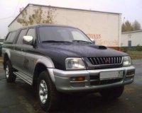 Dezmembrez mitsubishi picup usi faruri Mitsubishi L200 2003