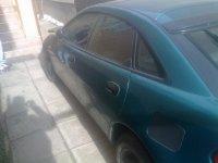 Vand mazda avariata partea dreapta far aripa Mazda 323 1996